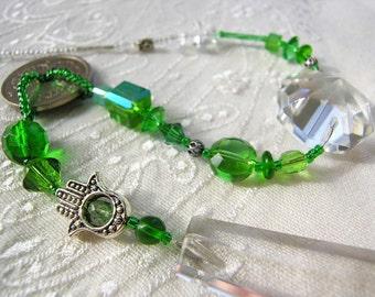 Green beaded Suncatcher, hamsa, repurposed vintage chandelier prism, Rainbow maker, Prosperity Chi-Swirler