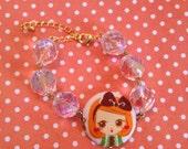 Children's/girl's crystal and button kawaii doll bracelet