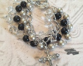 4 strand beaded bracelet with cross charm