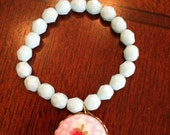 Children's/girl's pale turquoise bead and floral button bracelet