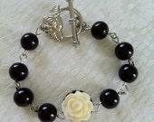 Children's/girl's rosary bead and cream rose bracelet