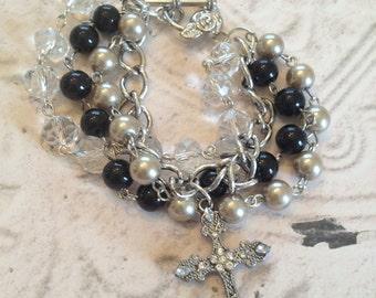 4 strand beaded bracelet with cross charm