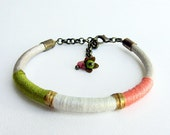 Thread bracelet. Coral pink, white and green  thread and pearl  leather  bracelet
