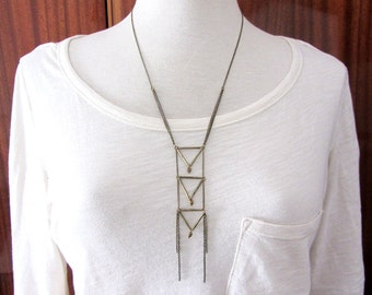 Geometric statement long triangle necklace with antique brass chain.