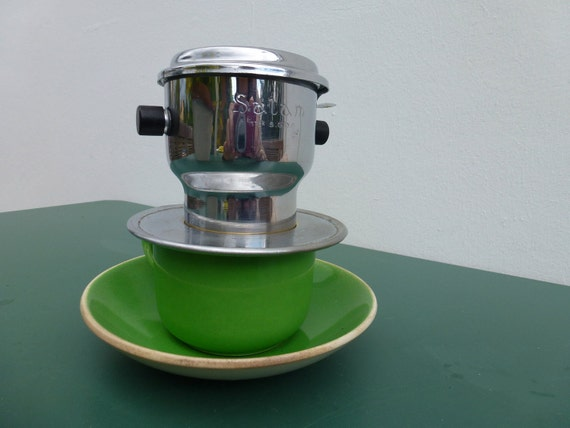 French vintage individual coffee press.