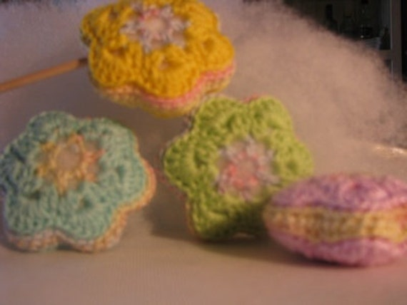 crocheted flowers in four joyful pastel colors - lilac, blue, green and yellow