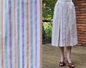 Vintage high waisted multi colored stripe pleated a line midi skirt with white buttons down the front and pockets
