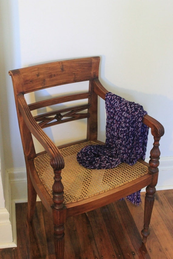 Meet Apelonia : A stunning chair with cane seating in great condition.