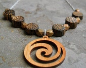 Carved Wooden Spiral NecklaceWith Dotwood and Geometric Brass Bead Detail