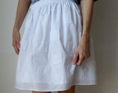 100% white cotton batiste gathered elastic waist skirt with self fabric pattern. Size M