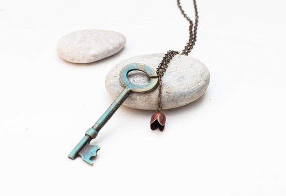 Long necklace with blue key and red tulip flower - skeleton key