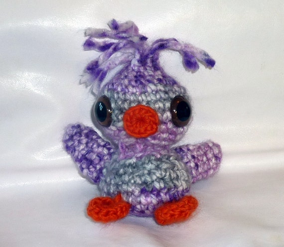 Crochet amigurumi purple and grey duck.