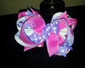 Pink, purple and white hairbow with mini pink glitter flower embellishment
