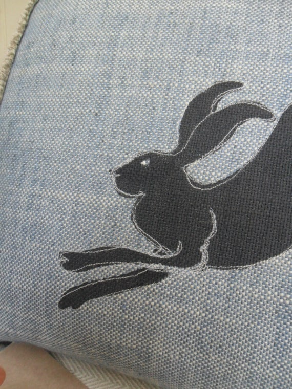 Hand printed enchanted hare blue cushion.