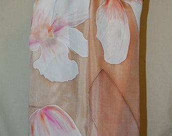 Hand painted silk scarf with white flowers and tan color background.