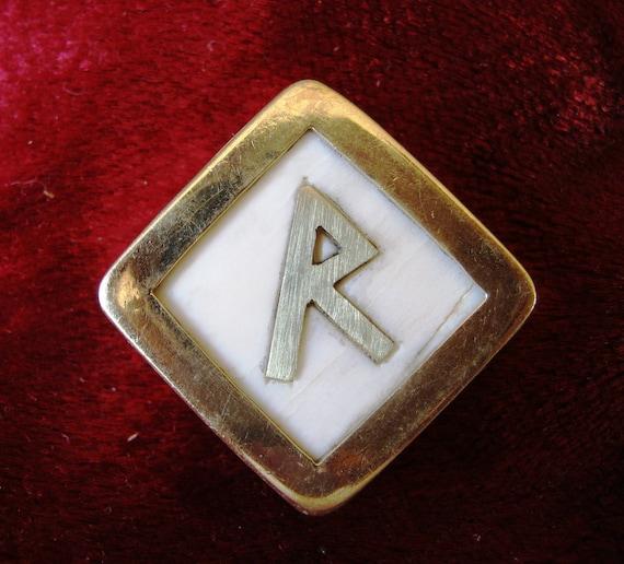 Rune pendant. Raidho pendant , bone and brass