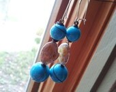 Metal Enamel Shells with Large Blue Spheres
