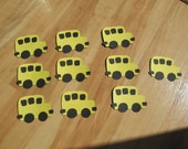 Ten yellow and black bus die cuts