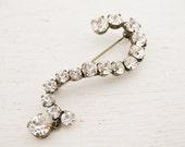 vintage 1950s clear rhinestones brooch. UNE PETITE QUESTION.
