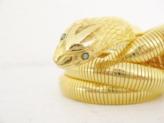 Snake belt. bright gold metal.