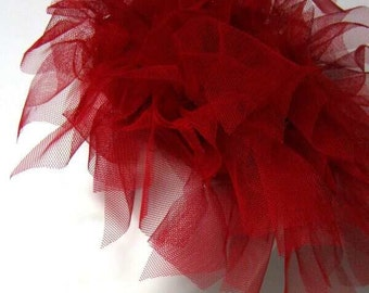 Red fascinator, tulle, very fashionable