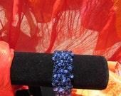 blue  crochet bracelet wire with glass beads blue purple shades