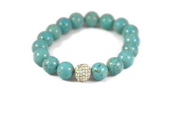 Turquoise Gemstone Beaded Bracelet with a Mother of Pearl Accent Bead.