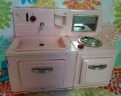 Reserved vintage retro childs toy a pink sink and stove combination it's as cute as a button