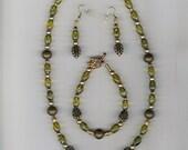 Beaded necklace, bracelet, earrings in olive green