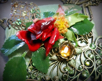 One of a kind mixed media necklace using brass stampings embellished with swarofski chrystals and rhinestones.