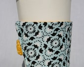 "Reusable ""Golden Summerville"" Coffee Sleeve: gold, white, light blue, black"