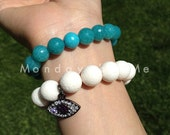 Natural white coral beaded bracelet with evil eye pendant