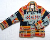 Vintage Santa Fe jacket xs or small with geometric design in neon orange, mustard yellow, red, black and grey.