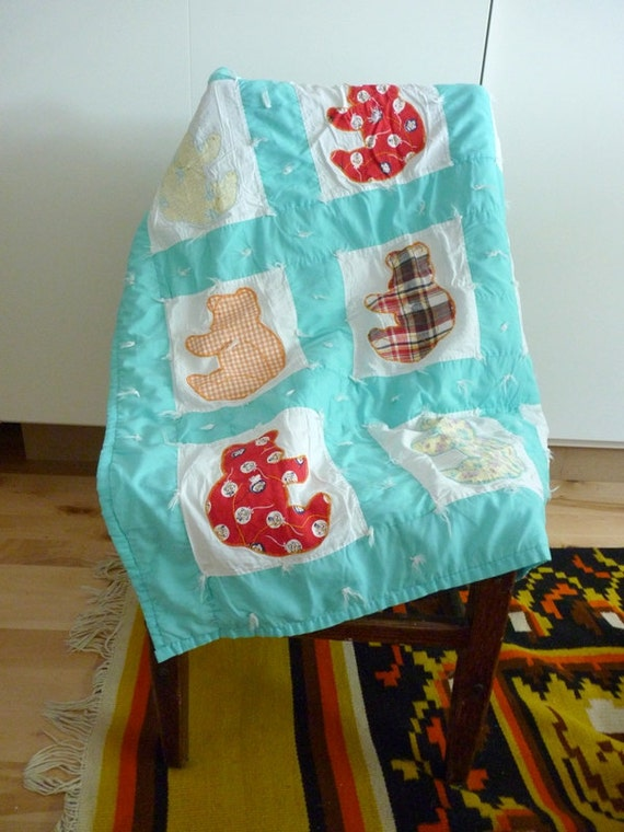 Vintage baby quilt. Mint green with white and colored applique bears and fuzzy yarn ties. Unisex.