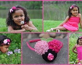 Three Wool Pom Pom Flowers in Light/Lt Pink, Hot Pink and Black With Clay Lady Bug and Pearl Accents, Are Placed  on a Satin Headband