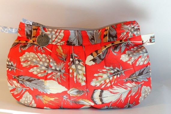 Handmade makeup bag,  jewelry bag , art supplies, travel and purse accessory.