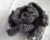 Hand knitted brooch pin