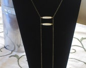 Chic modern 1920s/1930s vintage art deco inspired brass necklace. African brass bead necklace. Industrial metal necklace.