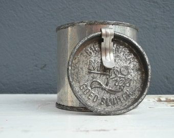 Old metal tin with lid
