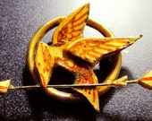 Hunger Games Katniss's Mockingjay Pin -- Help feed a Hungry Child Today
