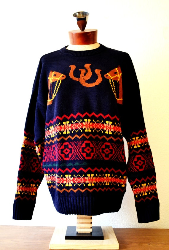 Knitted navy blue sweater with two brown horses and horseshoes design plus a fair isle pattern.