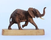 Detailed avocado wood elephant