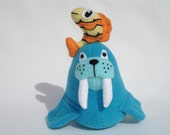 Toy plush walrus with stuffed animal fish friend in turquoise and orange fleece and felt