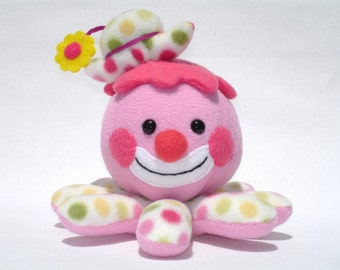 Stuffed octopus clown toy with pink polka dots and flower hat