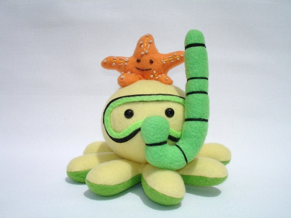 Plush octopus toy with snorkel and starfish friend in yellow, green, and orange fleece