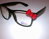 Hello. Here are some kitty eye glasses with red bow ( non - prescription )