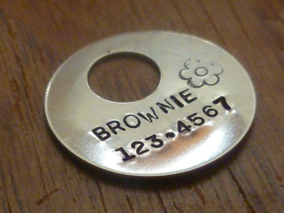 A hand stamped pet ID tag that is cheaper than the pet store