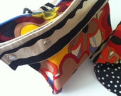 Diaper bag/Diaper clutch/Make up bag You name it... and a funky changing pad to go with it.