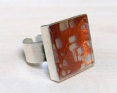 SQUARE METAL RING. Beautiful copper leaf floating over a silver background.