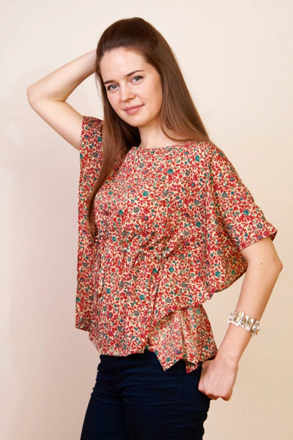 Last one. THE DANCER UPSTAIRS Kaftan cropped poncho top in floral print and empire waist. Great gift for her.